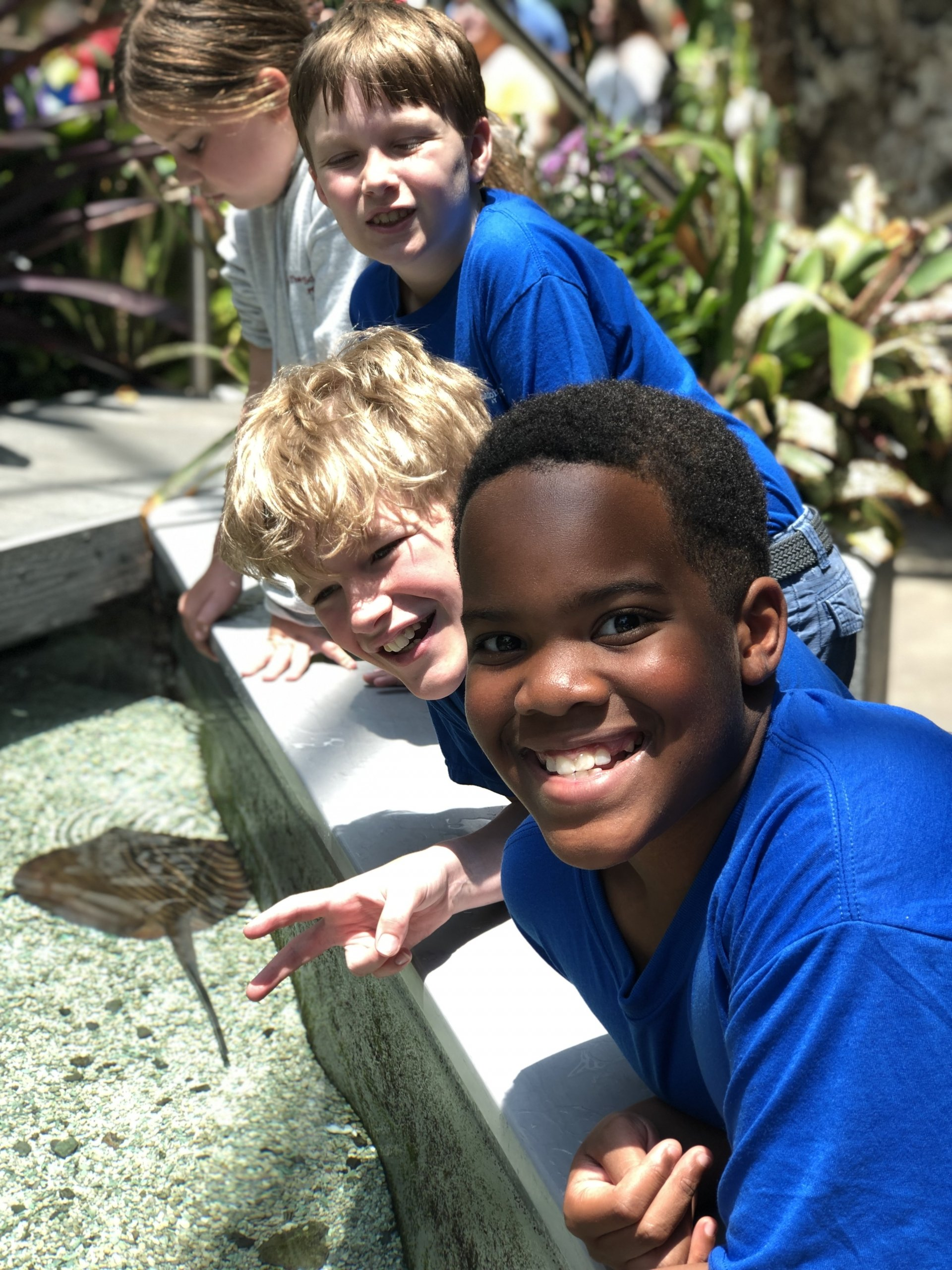 Music education is so much more than a great children's choir. It's also what you learn on summer tour experiences. This is a photo of singers at an aquarium on the 2019 summer tour.