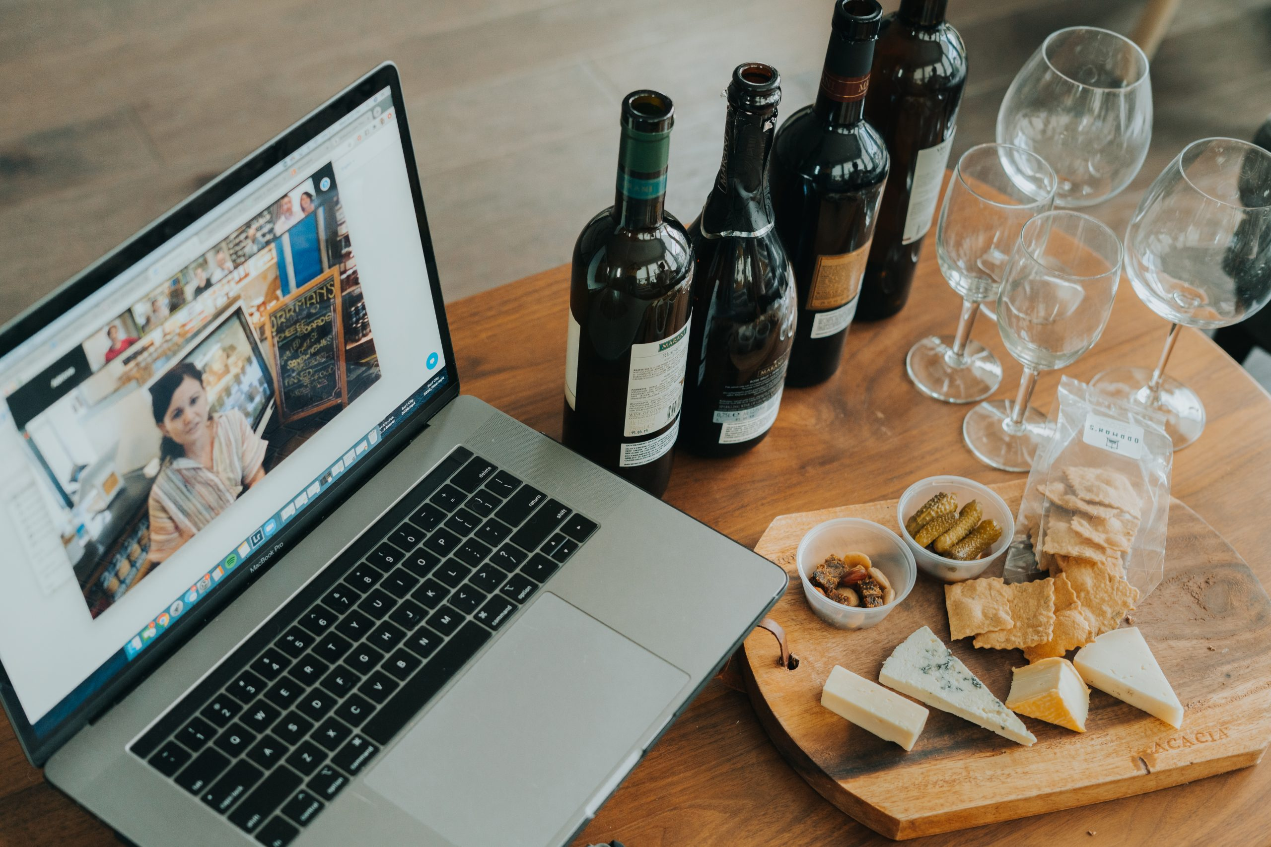 Wine and cheese seminar with laptop on Zoom